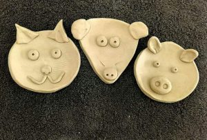 pottery drop in day - animal faces